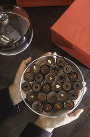 stock photo of bonbon  - Hand holding chocolate bonbons - JPG