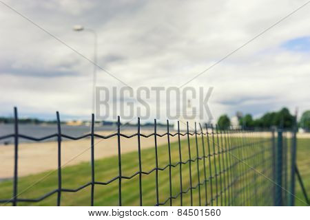 The Ferry Is In Port Behind The Fence