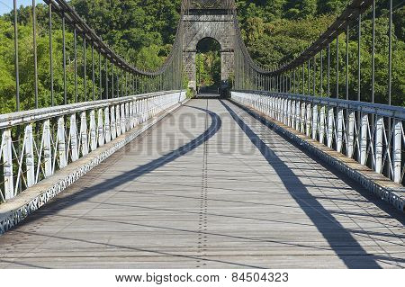Old suspension Bridge in Pont Des Anglais, St. Anne, Reunion Island, France.