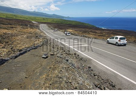 People enjoy the view to the asphalt road over volcanic lava in Sainte-Rose De La Reunion, France.
