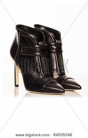 Women's Black Boots On A White Background