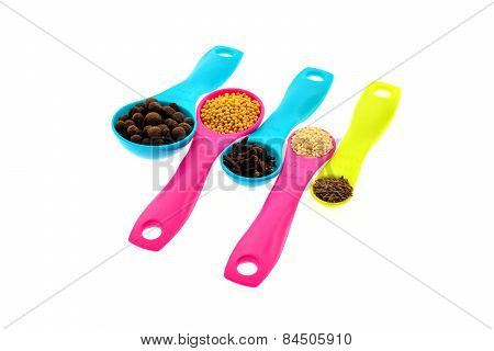 Spices And Grains On Measuring Spoons