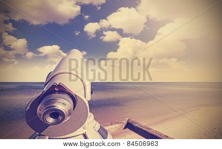 Retro Toned Picture Of A Telescope On Beach.
