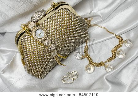 Set Of Women's Accessories On A White Silk Background