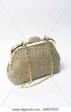 Gold Clutch With Diamonds On A White Background