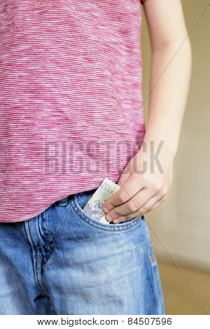 Boy Puts Cash Bank Note Into Pocket