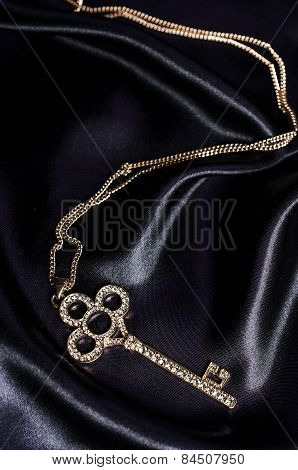 Gold Key Pendant On Black Silk