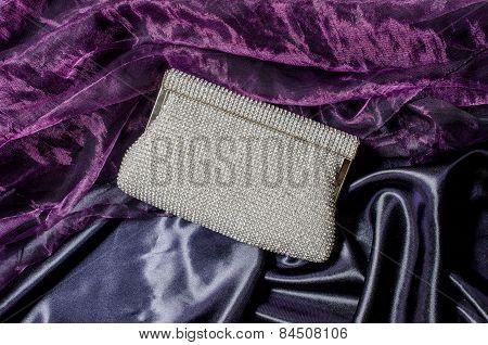 White Clutch Inlaid Diamonds On Silk Background