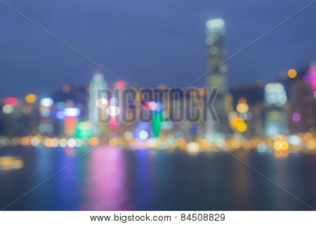 City light bokeh background with water reflection