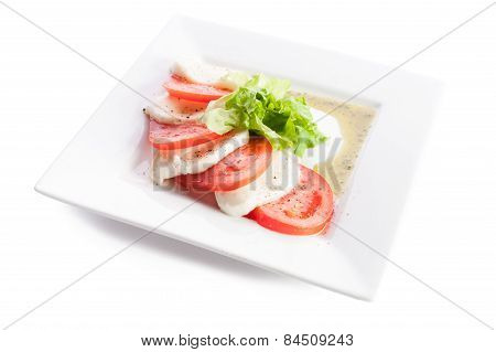 Sliced Tomatoes And Cheese With Lettuce On A White Background