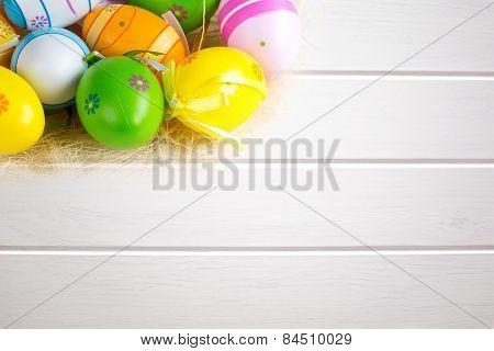 Easter Eggs  On White Wooden Board