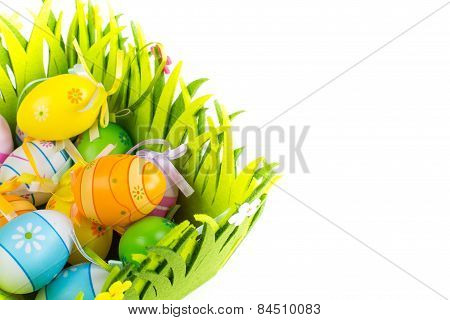 Green Grass Box With Easter Eggs On White Background