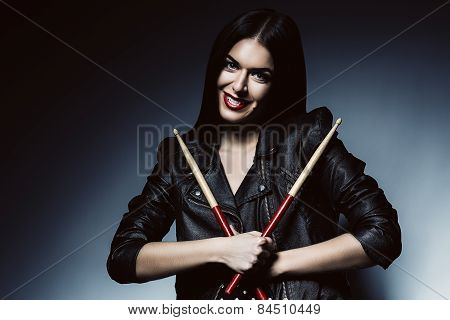 Smiling Drummer Woman With Drum Sticks