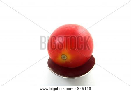 tomato  and spoon