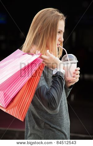 Teenage Girl Out For Shopping, Holding Paper Bags And Milkshake