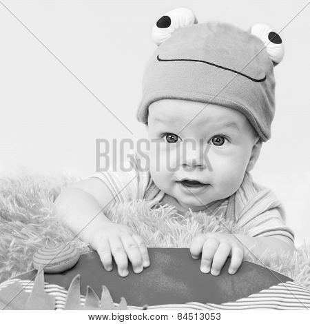 Cute Baby Playing In The Hat Frog