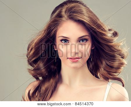 Smiling Beautiful girl brown hair with an elegant hairstyle