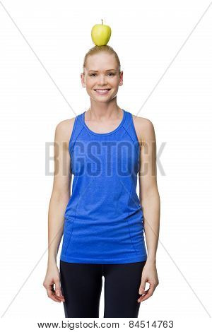 woman in fitness clothes with apple