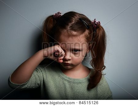 Crying Kid Girl With Hand Near Eyes Looking Unhappy