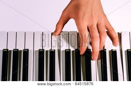 Pianist Playing On A Synthesizer, Isolated On A Gradient Gray