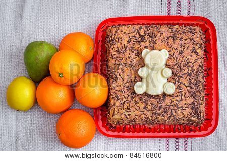 Delicious Cake On A Platter And Fruit.