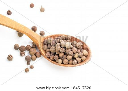 Aromatic Allspice In Wooden Spoon. Isolated