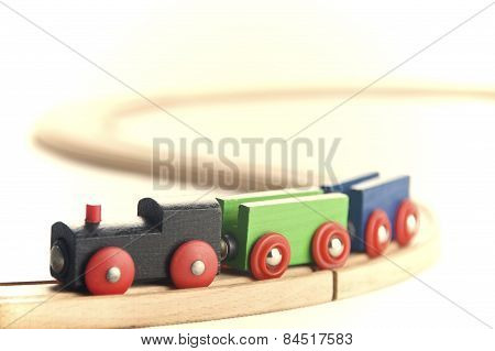 Wooden toy train set isolated on white