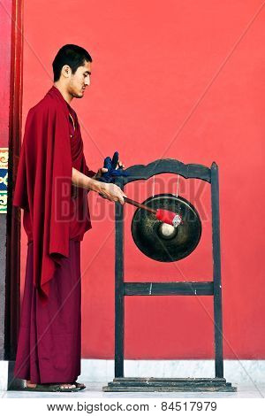 Monk Hitting the Gong
