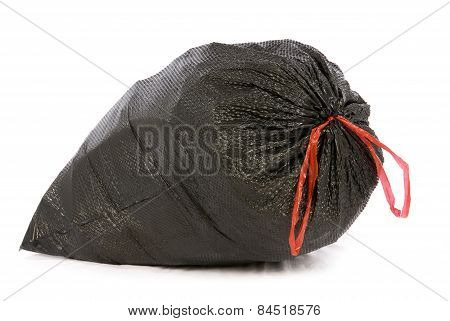 Big Black Trash Or Garbage Bag With Red Tie