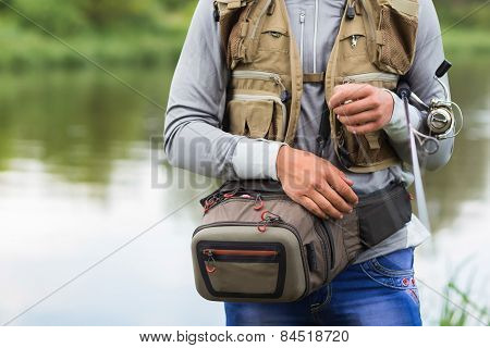 A young fisherman posing at the camera