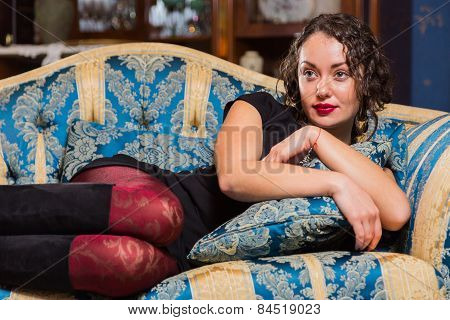 Lonely girl on the couch