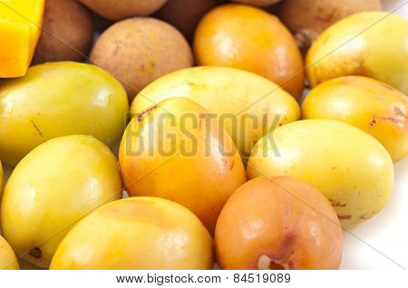 Oriental fruit plate, background of fruits