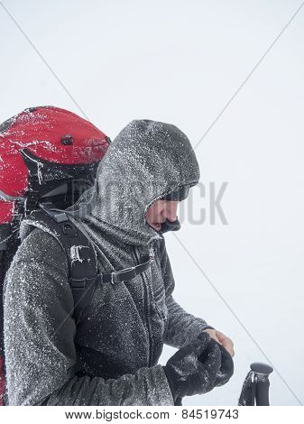 Snow-covered Man With A Backpack In A Fog.