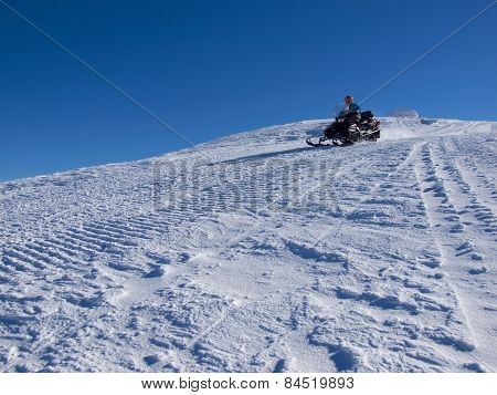 The Man Riding On The Snowmobile.