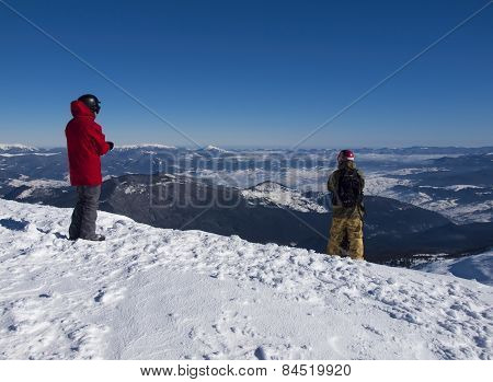 Snowboarder Stands Before The Descent From The Mountain.
