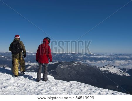 Snowboarders In The Mountains.