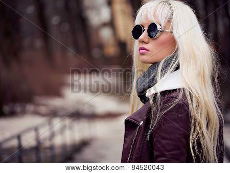 Beautiful Girl In Sunglassses Outdoors