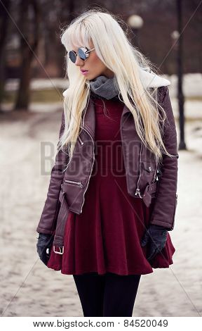 Pretty Blonde Woman In Posing Outdoors
