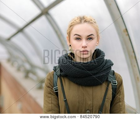 Outdoors city portrait of young blonde hipster woman