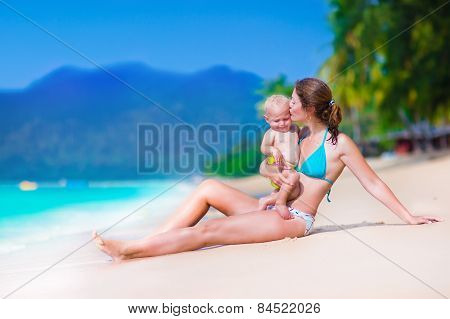 Mother And Baby At A Tropical Beach