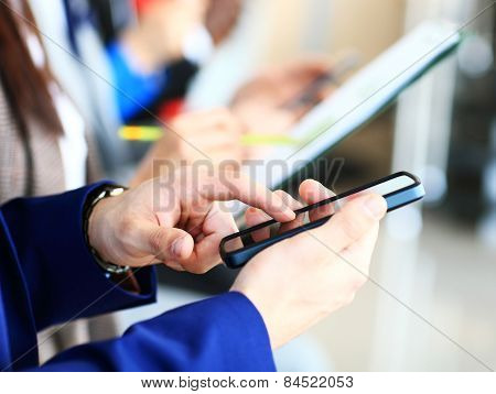 Businessman using modern smartphone or mobile phone. New technologies for success workflow concept