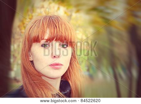 Pretty Red Hair Girl Looks At Camera.soft Bokeh And Toned Image.