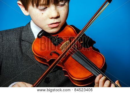 Red-haired Preschooler Boy With Violin, Music Concept