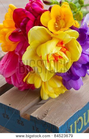 posy  of spring flowers on wooden table