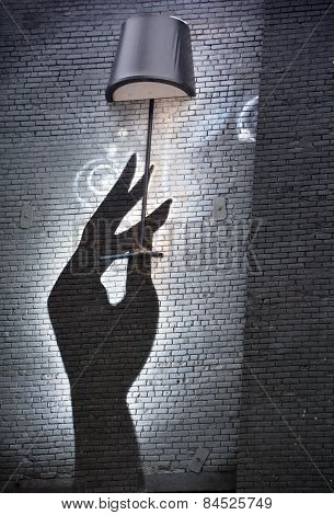 Street art Montreal hand with lamp