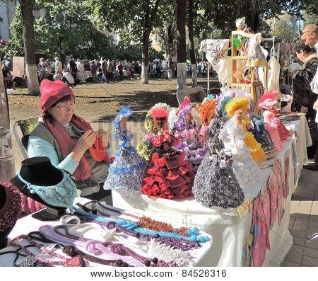 Street Stand Saleswoman Of Souvenir Dolls
