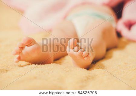 baby's legs. child hid.