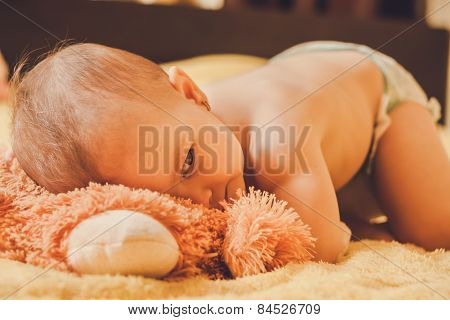 Baby lying on the bed and spies