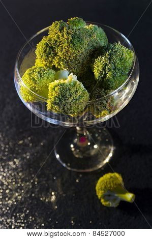 Healthy diet with pieces of broccoli in an elegant cup