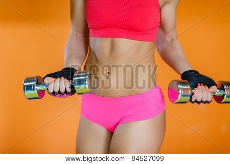 Sporty Woman With Dumbbells.